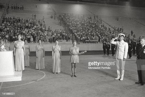 At Panathenaic Stadium Prince Constantine II of Greece greeting the Olympic flame in the presence of the vestal virgins Athens August 1960