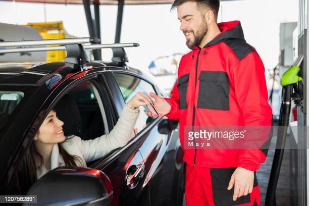 at petrol station - combustível fóssil imagens e fotografias de stock
