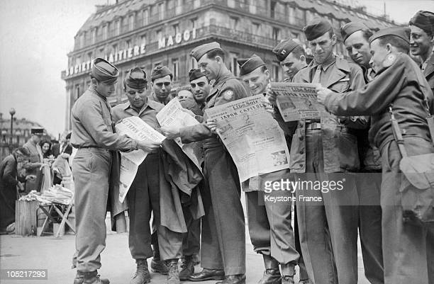 At Place De L'Opera In Paris On August 10 American Soldiers Read Of Japan'S Surrender In French Newspapers After The Second American Bomb Had Been...