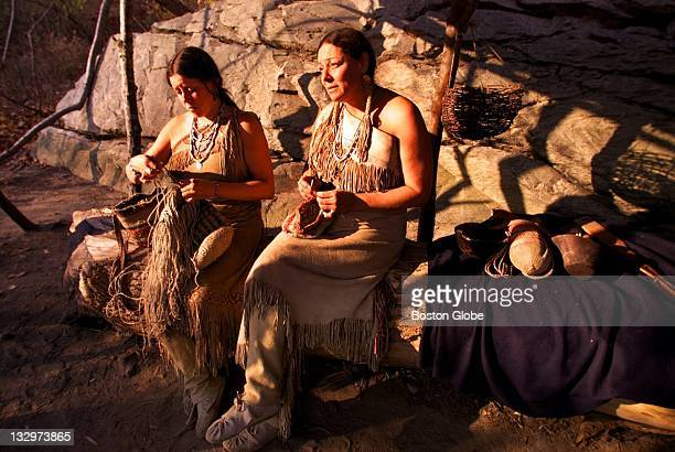 At Plimoth Plantation Wampanoags Kitty Miller left and Carol Wynne make bags at their homesite at the Plantation They live in Mashpee