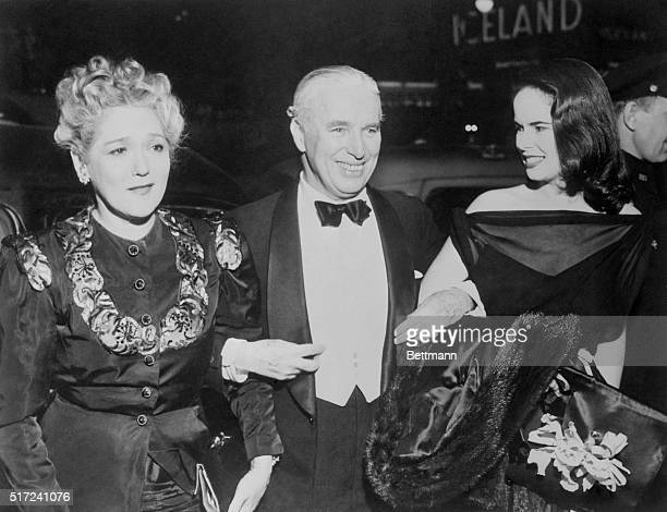 At Premiere of New Chaplin Picture New York New York Mary Pickford is shown with Mr and Mrs Chaplin as they attended the premiere of Chaplin's new...