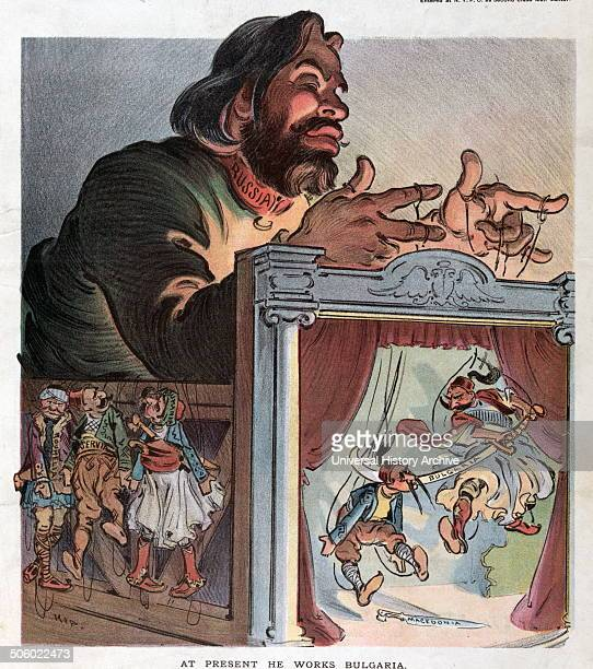 At present he works Bulgaria by Udo Keppler 18721956 artist 1903 Illustration shows a puppeteer labeled Russia with marionettes labeled Bulgaria and...