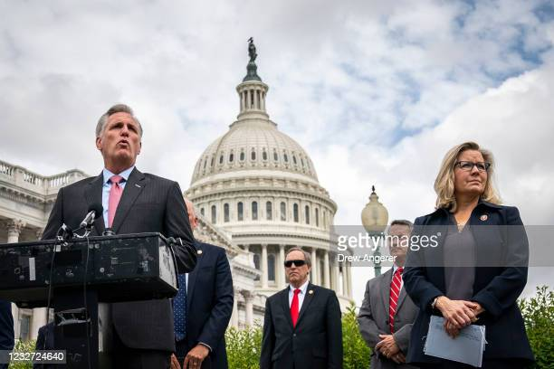At right, Rep. Liz Cheney stands with House Minority Leader Rep. Kevin McCarthy as he speaks during a news conference outside the U.S. Capitol, on...