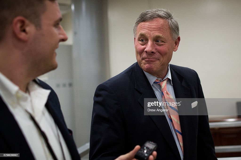 At right, Sen. Richard Burr (R-NC) speaks with reporters after a vote at the U.S. Capitol, May 9, 2016, in Washington, DC. Senate Democrats defeated a procedural vote on an energy bill, which increases funding for the Department of Energy and Army Corps of Engineers.