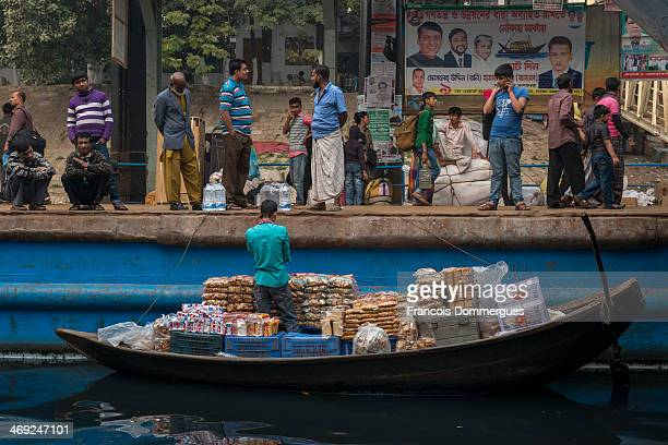 At Sadhargat, small boats sell a variety of edible goods to passengers about to board the ferries.