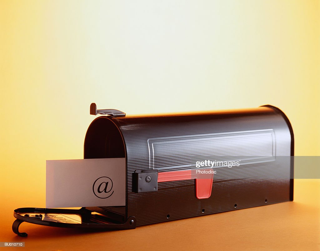 At Sign in Mailbox : Stock Photo