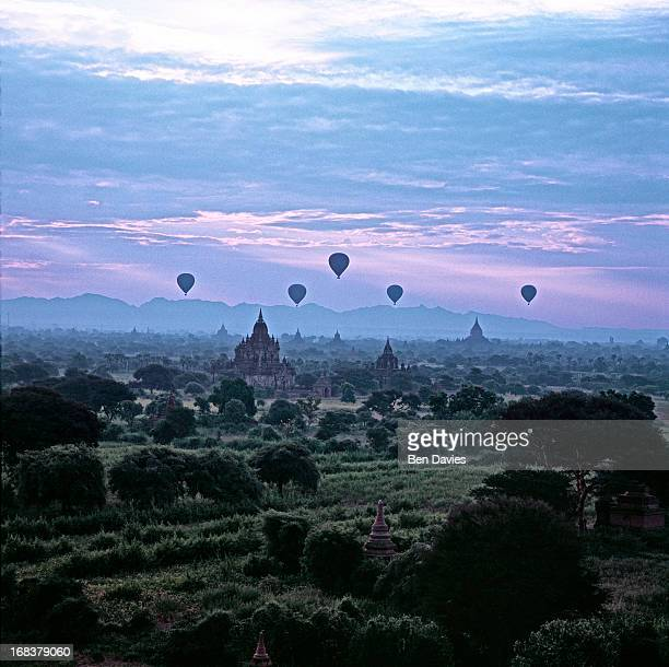 At sunrise five hot air balloons fly over the great ancient temples of Bagan as viewed from the Shwesandaw Temple In all there are more than 2000...
