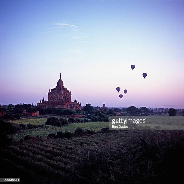 At sunrise five hot air balloons fly over the great ancient temples of Bagan one of the major tourist attractions of Myanmar In all there are more...