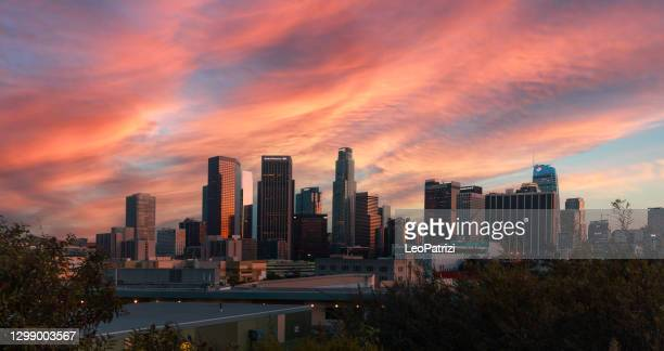 dtla at sunset with a pink color sky - los angeles stock pictures, royalty-free photos & images