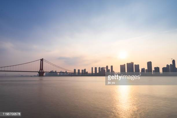 at sunset, wuhan yingwuzhou yangtze river bridge, hubei province, china. - wuhan stock pictures, royalty-free photos & images