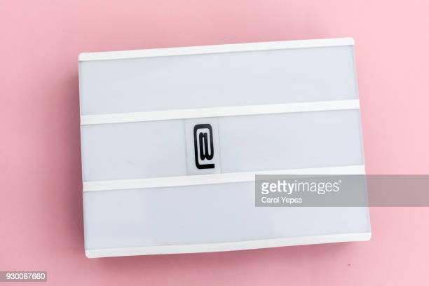 at symbol in white lightbox.Copyspace
