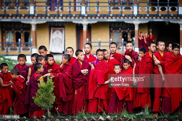 At Tamshing Goemba, a large Buddhist monastery in Bumthang, central Bhutan, young Buddhist monks line up and wait with excitement to greet the King...