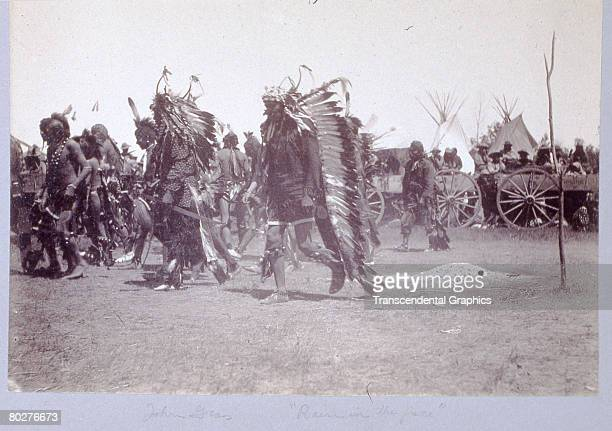 At the 10year memorial of the Battle of Little Bighorn unidentified Lakota Sioux dance in commemoration of their victory over teh United States 7th...