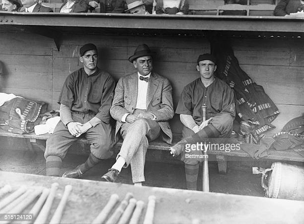 At the 1914 World Series with Philadelphia, Boston Braves' pitchers Bill James and Dick Rudolph, with manger George Stallings between them, sit in a...