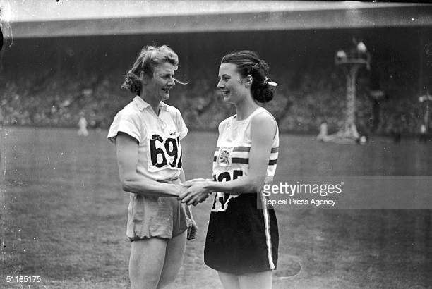 At the 1948 London Olympics women's 80 metres hurdles silver medallist Maureen Gardner congratulates the winner of the event Fanny BlankersKoen of...