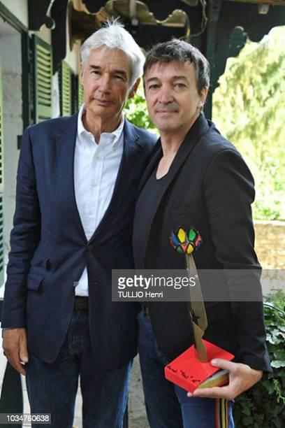 at the 1st Edition Festival Les Ecrivains chez Gonzagues Saint Bris 2018 Edouard Saint Bris and the singer Cali posing with the price of book 2018...