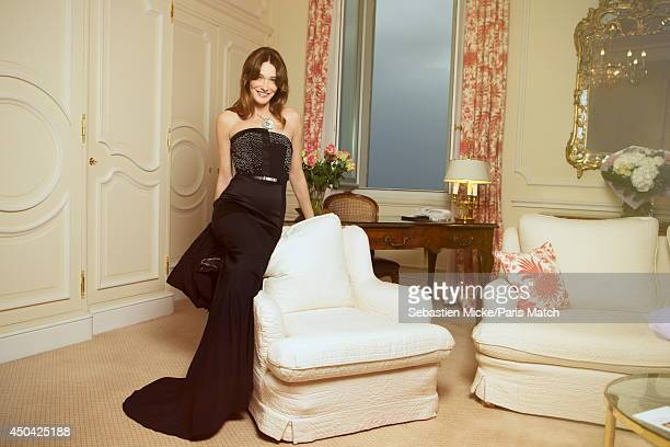 at the 21th Gala of AmFar Cinema Aganist AIDS Carla Bruni Sarkozy wearing a Maxime Simoens dress with a Bulgari jewelry is photographed for Paris...