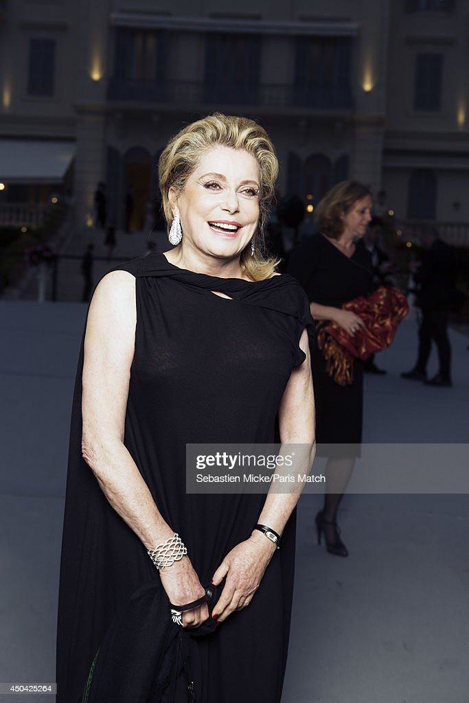 at the 21th Gala of AmFar Cinema Aganist AIDS, Catherine Deneuve wearing a Vionnet dress with a Boucheron jewelry is photographed for Paris Match in Cap d'Antibes at the Hotel Cap-Eden-Roc on May 22, 2014;