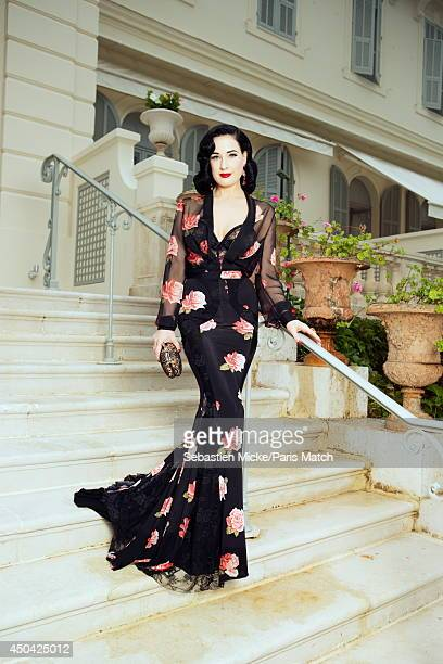 at the 21th Gala of AmFar Cinema Aganist AIDS Dita Von Teese wearing a Blumarine with a Chopard jewelry dress is photographed for Paris Match in Cap...
