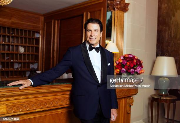 at the 21th Gala of AmFar Cinema Aganist AIDS John Travolta is photographed for Paris Match in Cap d'Antibes at the Hotel CapEdenRoc on May 22 2014