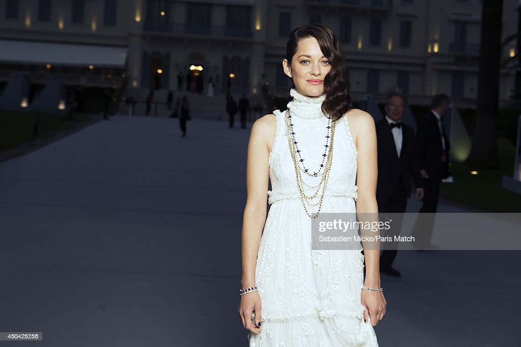 at the 21th Gala of AmFar Cinema Aganist AIDS, Marion Cotillard wearing a Alexander McQueen dress is photographed for Paris Match in Cap d'Antibes at the Hotel Cap-Eden-Roc on May 22, 2014;