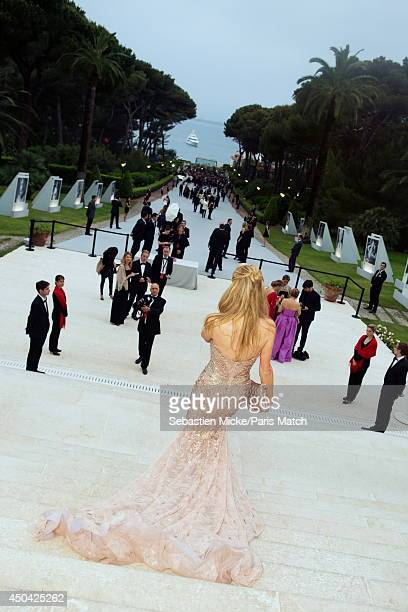 at the 21th Gala of AmFar Cinema Aganist AIDS Paris Hilton wearing a Versace dress is photographed for Paris Match in Cap d'Antibes at the Hotel...