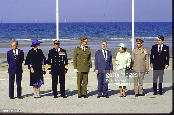 At the 40th anniversary commemoration of DDay world leaders pose on Omaha Beach Normandy France June 6 1984 Pictured are from left Canadian Prime...
