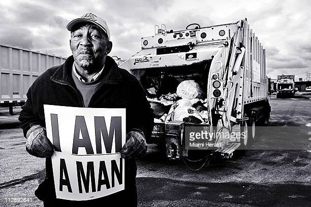 At the age of 71 sanitation worker Ben Jones is still working so he can pay off the mortgage on his house Jones holds a replica of the sign 'I AM A...