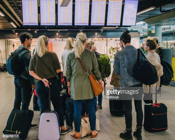 at the airport in amsterdam - schiphol airport stock photos and pictures