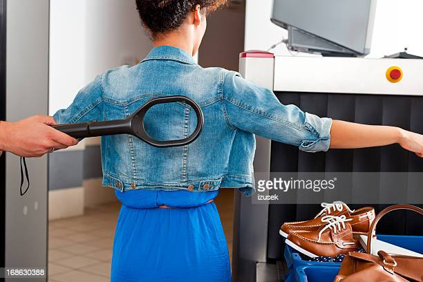 at the airport security check - security scanner stock pictures, royalty-free photos & images