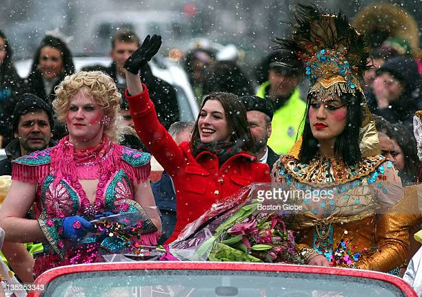 At the Annual Hasty Pudding Woman of the Year Roast actress Anne Hathaway rides in a convertible as she waves to the crowd on the way to the theater