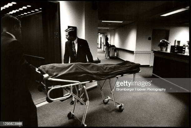 At the Bailey-Boushay House, two unidentified coroners transport an AIDS patient's body to the mortuary, Seattle, Washington, 1992. The...