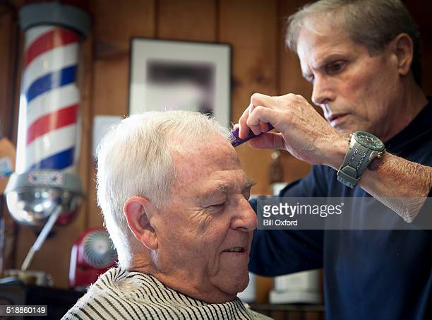at the barber - barber pole stock photos and pictures