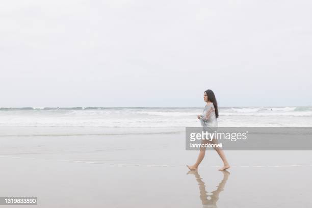 at the beach - sheer fabric stock pictures, royalty-free photos & images