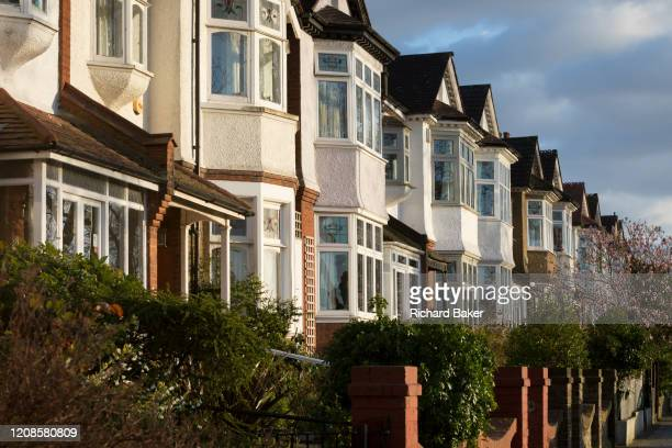 At the beginning of the second week of the UK's Coronavirus lockdown a street of Edwardian period homes where neighbours are behind their locked...