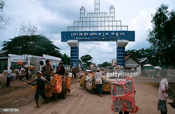 At the border town of Poipet, goods are transiting from Thailand by human drawn carts..