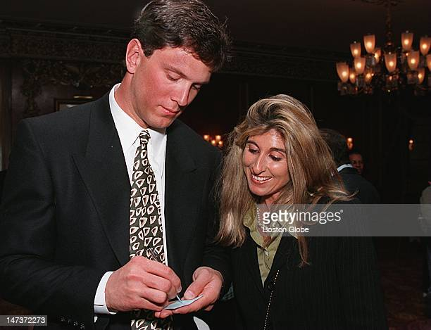 At the Boys and Girls Club Gala Patriots QB Drew Bledsoe signing autograph for Michele Friedmann of Brookline