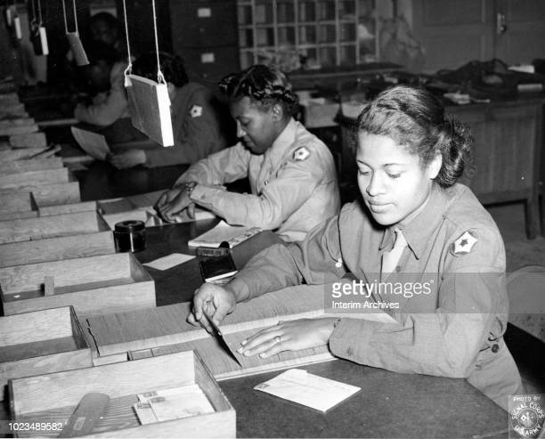 At the Camp Breckinridge Post Locator Department members of the Women's Army Corps sort and identify incorrectly addressed mail for proper routing...