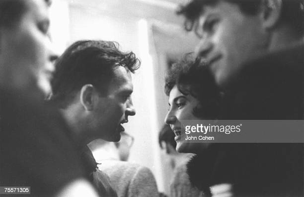 At the cast party for the Robert Frank and Alfred Leslie film 'Pull My Daisy' American writer Jack Kerouac talks with an unidentified guest New York...