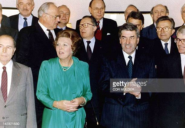 At the castle of Neercanne Queen Beatrix of The Netherlands poses with all the government leaders and French President Mitterrand for an official...