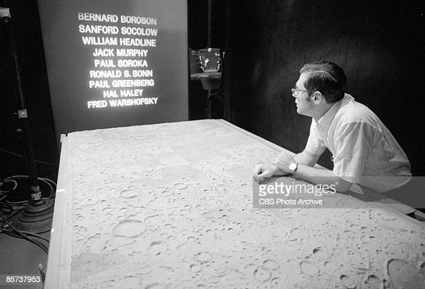At the CBS News Space Center in New York a cameramen shoot images of a model of the moon's surface and run the CBS News credits in anticipation of...