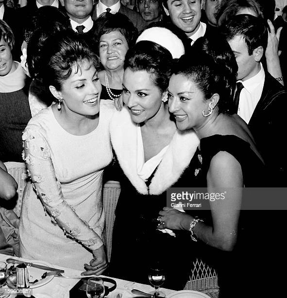 At the christening of her daughter Rosario the Spanish singer and dancer Lola Flores with the Spanish dancers and singers Paquita Rico and Carmen...