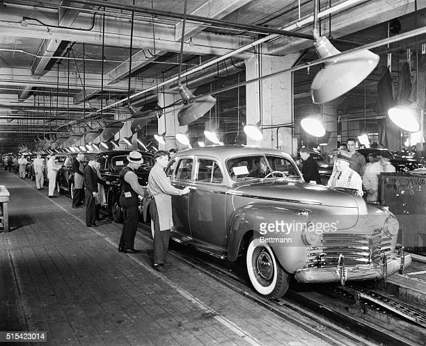 At the Chrysler Motor Co cars go down the final inspection line