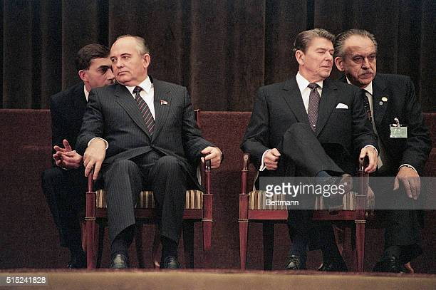 At the closing ceremony for the Geneva Summit, Soviet leader Mikhail Gorbachev and US President Ronald Reagan face away from each other, 21st...