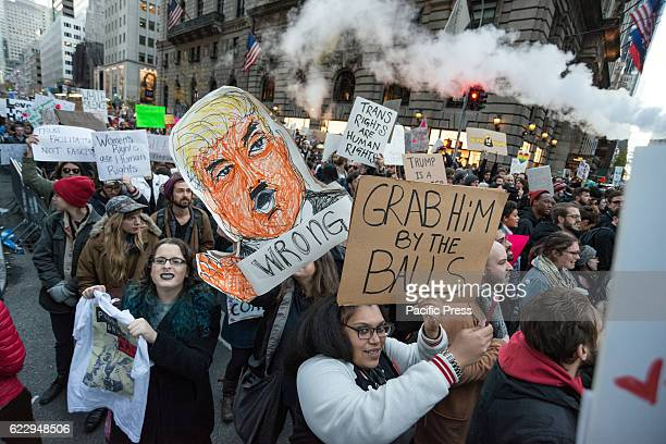 At the conclusion of a mass rally near Trump Tower a demonstrator displays a sign Following a rally on the fourth day after the US Presidential...