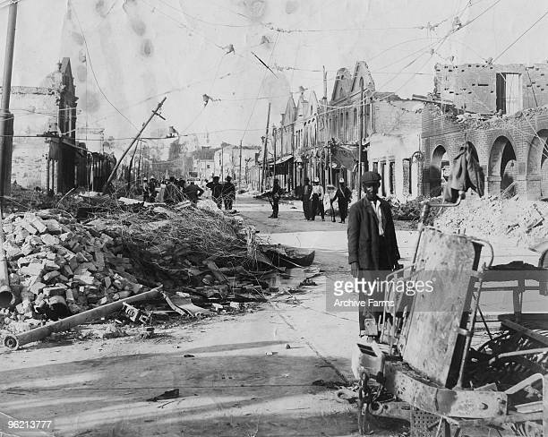 At the corner of King and Harbor Streets Kingston Jamaica after the 1907 earthquake Wreckage of an electric streetcar is on right of picture Taken by...