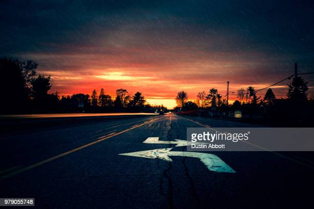 at the crossroads - dustin abbott stock pictures, royalty-free photos & images