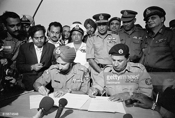 At the Dacca Race Course Gen Jagjit Singh Aurora Chief of Staff of the Indian Army and Lt Gen Assan Ali Khan Niazi of the Pakistani Army sign the...
