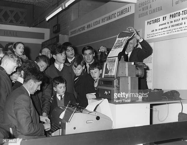 At the Daily Mail Schoolboys and Girls Exhibition in Olympia a demonstration of pictures being received by phototelegraph from the London office of...