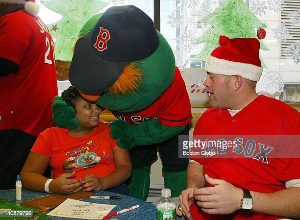 At the Dana Farber Cancer Institute patient Genesis Pizarro 12 from New Bedford gets a hug from Red Sox mascot Wally the Green Monster as Red Sox's...